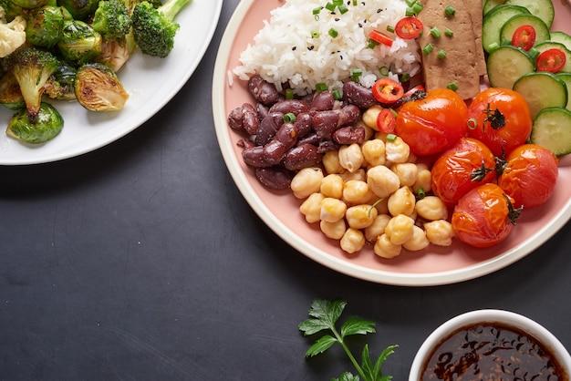 Healthy organic tofu and rice buddha bowl with veggies.