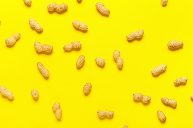 Healthy peanut nuts on color surface
