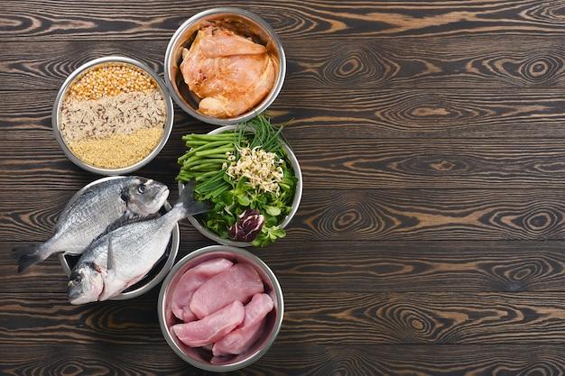 Healthy pet food ingredients in individual bowls