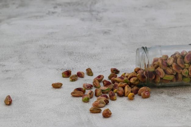 Healthy pistachios spread on floor concept