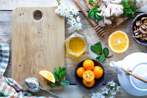 Healthy products for immunity boosting on wooden background with copy space top view. lemon, nuts, ginger to immune system