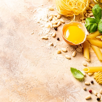 Healthy raw ingredients for italian pasta sauce carbonara