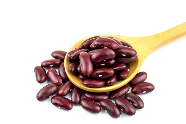 Healthy red bean on wooden spoon use a white background.