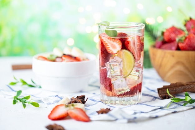 Healthy refreshing energy ice cold strawberries lemonade with lime