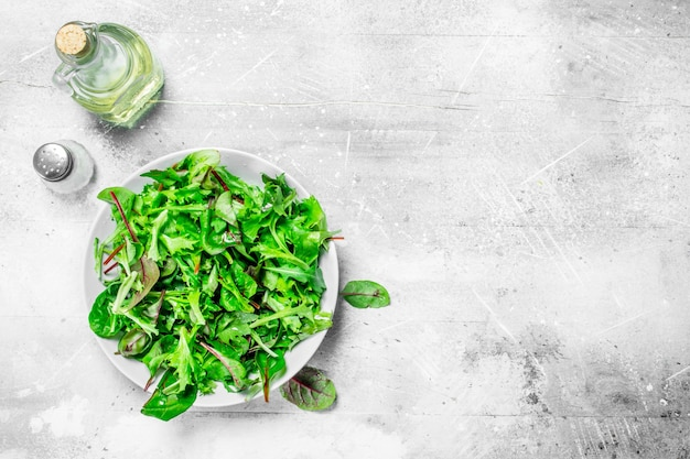 Healthy salad. arugula salad in a bowl. on a rustic background.