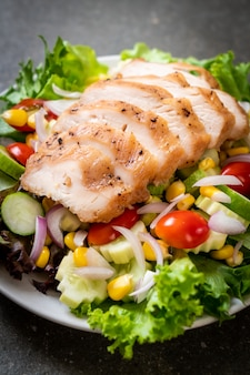 Healthy salad bowl with chicken breast