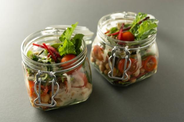 Healthy salad in glass jar with fresh vegetables. healthy food, diet, detox.