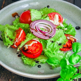 Healthy salad, leaves mix, cucumber, tomato