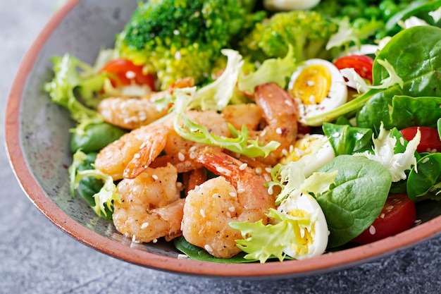 Healthy salad plate. fresh seafood recipe. grilled shrimps and fresh vegetable salad, egg and broccoli. grilled prawns. healthy food