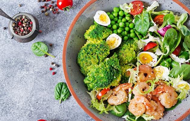 Healthy salad plate. fresh seafood recipe. grilled shrimps and fresh vegetable salad, egg and broccoli. grilled prawns.