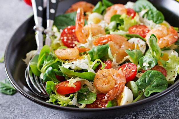 Healthy salad plate. fresh seafood recipe. grilled shrimps and fresh vegetable salad and egg. grilled prawns. healthy food.