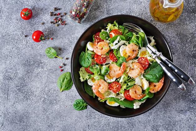 Healthy salad plate. fresh seafood recipe. grilled shrimps and fresh vegetable salad and egg. grilled prawns.