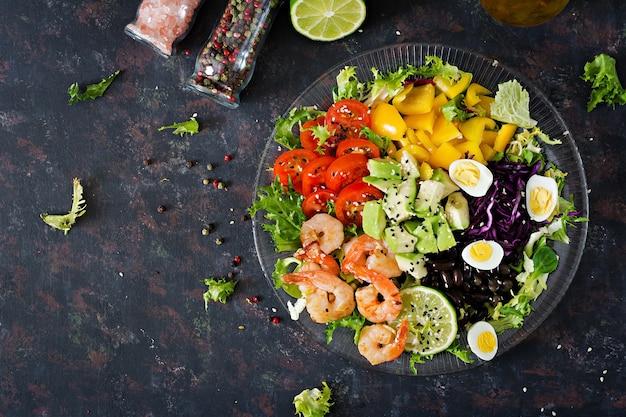 Healthy salad plate. fresh seafood recipe. grilled shrimps and fresh vegetable salad