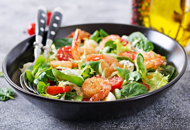 Healthy salad plate. grilled shrimps and fresh vegetable salad and egg.  healthy food.