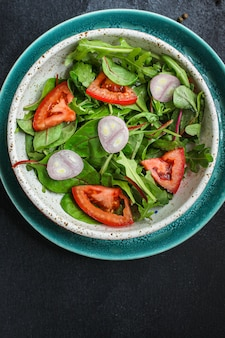 Healthy salad tomato, mix leaves, onions and other ingredients