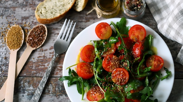 Healthy salad with arugula and cherry tomatoes with mustard sauce