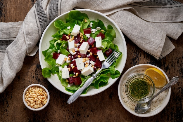 Healthy salad with beet, curd, feta and pine nuts, lettuce. low carb keto ketogenic dash diet