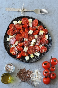 Healthy salad with cherry tomatoes and cheese