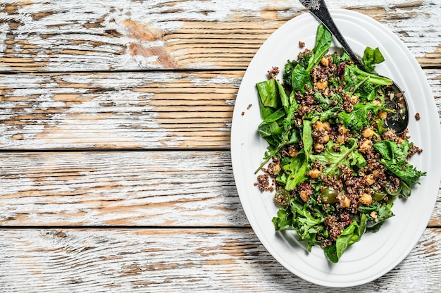 Healthy salad with spinach,quinoa and roasted vegetables. super food. white background. top view. copy space.