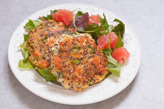 Healthy salmon quinoa kale burger