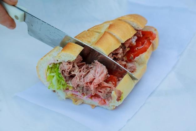 Healthy sandwich made of a fresh seeded roll, cut