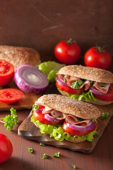 Healthy sandwich with ham tomato and lettuce