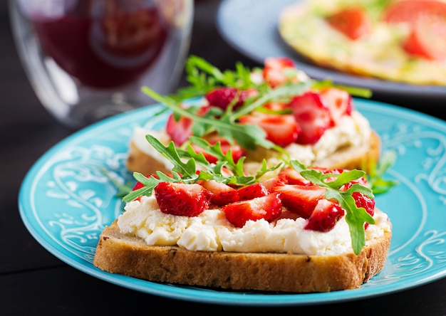 Healthy sandwich with strawberry and cream cheese