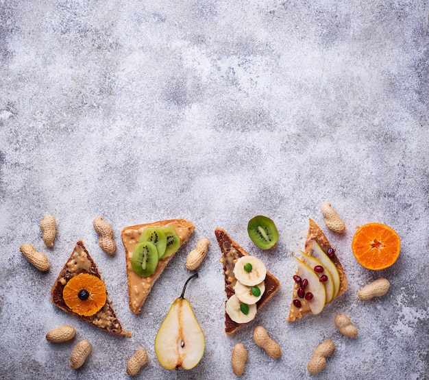 Healthy  sandwiches with peanut butter and fruits