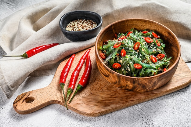 Healthy seaweed chuka salad with greens and red chili pepper