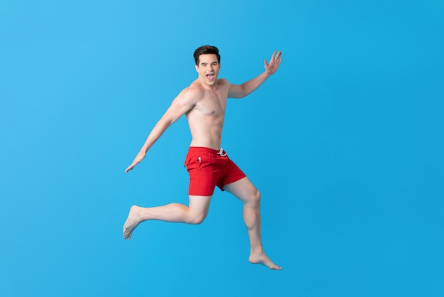 Healthy shirtless handsome caucasian man in summer short pants jumping