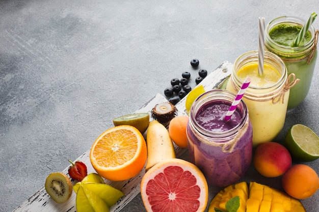 Healthy smoothie jars with fruit
