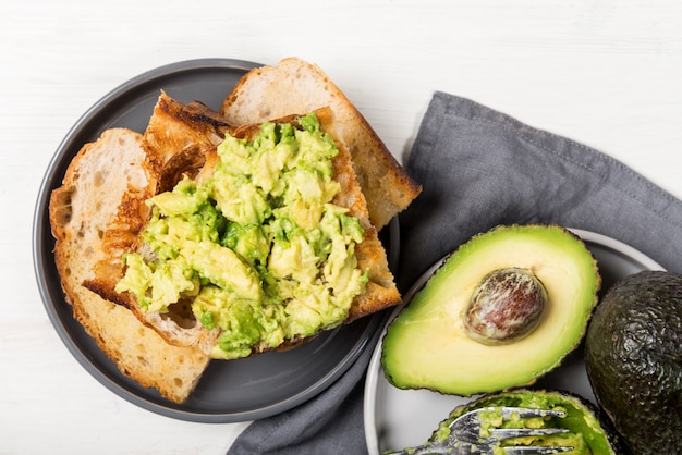 Healthy snack of avocado toasts from sourdough bread