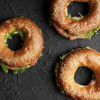 Healthy snack. bagels with salmon and arugula