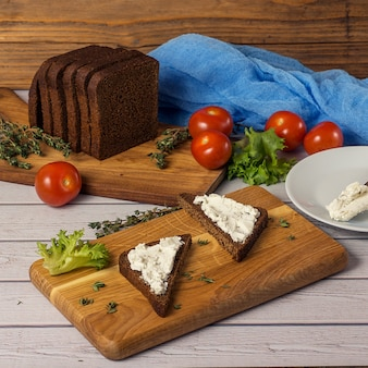 Healthy snacks sandwiches with goat cheese, salad, cherry tomatoes