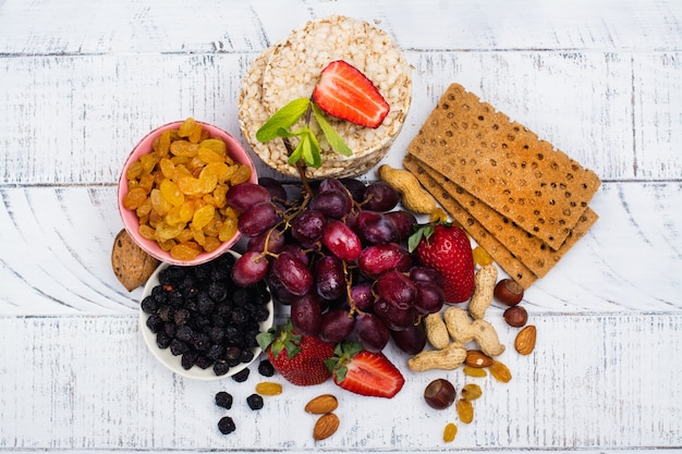 Healthy snacks on white wooden table