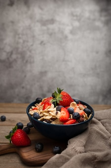 Healthy spelt breakfast with strawberries and blueberries