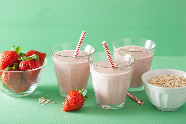 Healthy strawberry oat smoothie in glass