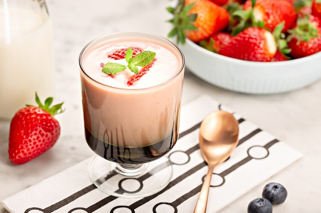 Healthy strawberry smoothie in glass