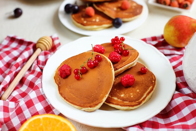 Healthy summer breakfast,homemade classic american pancakes with fresh berry and honey