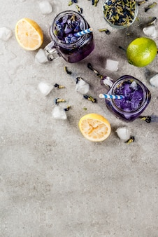 Healthy summer cold beverage, iced organic blue and violet butterfly pea flower tea