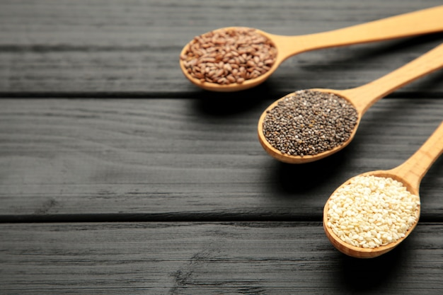 Healthy superfood sesame, sunflower seeds, flax seeds and chia on black