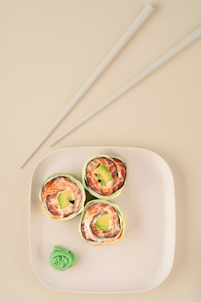 Healthy sushi roll with cucumber, salmon and avocado