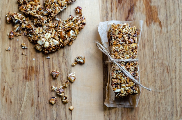 Healthy sweet bars with nuts, sesame, cereals, and honey