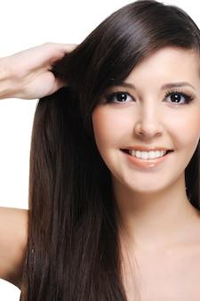 若い美女の健康な太いストレートヘア