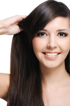 Healthy thick straight hair of young beautiful woman