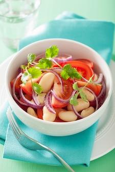 Healthy tomato salad with white beans onion cilantro