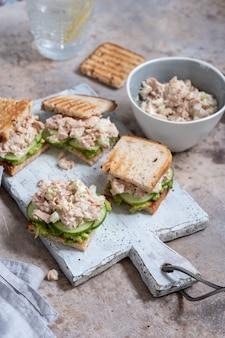 Healthy tuna sandwich with avocado and cucumber