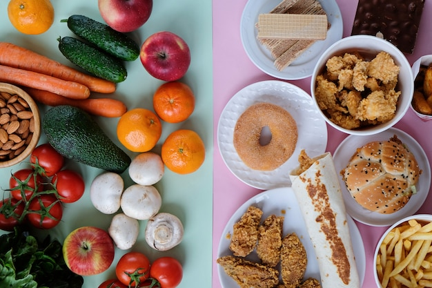 Healthy and unhealthy fast food on pink and green