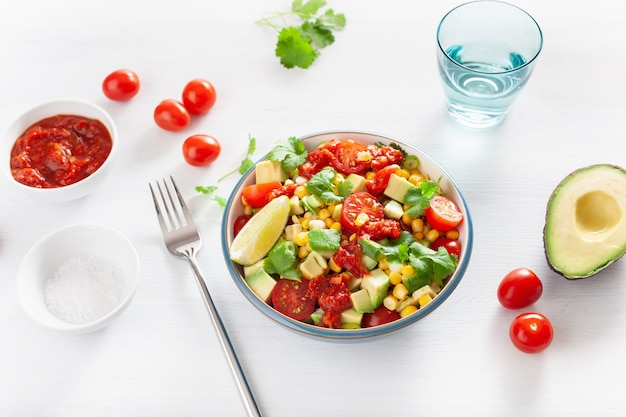 Healthy vegan avocado sweetcorn tomato salad