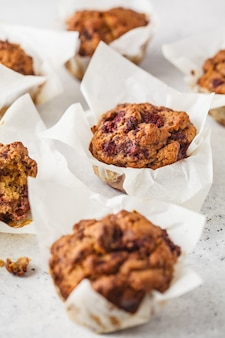 Healthy vegan berry muffins on a white background.